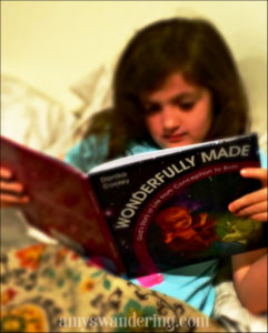 Amy's Daughter of Amy's Wanderings with their copy of Wonderfully Made: God's Story of Life from Conception to Birth for kids from ages 5-11.
