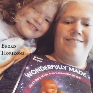 LaRee & Daughter of Broad Horizons with their copy of Wonderfully Made: God's Story of Life from Conception to Birth for kids from ages 5-11.