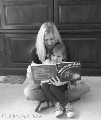 Heather & Daughter of Cultivated Lives with their copy of Wonderfully Made: God's Story of Life from Conception to Birth for kids from ages 5-11.