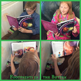 Debra's kids from Footprints in the Butter with their copy of Wonderfully Made: God's Story of Life from Conception to Birth for kids from ages 5-11.