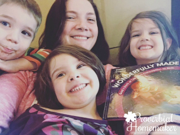 Tauna & Family of Proverbial Homemaker with their copy of Wonderfully Made: God's Story of Life from Conception to Birth for kids from ages 5-11.