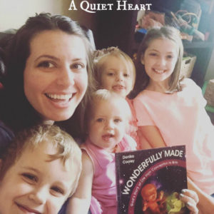 Veronica & Family from A Quiet Heart with their copy of Wonderfully Made: God's Story of Life from Conception to Birth for kids from ages 5-11.